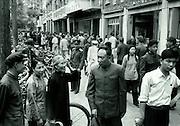 C012-4_Tom Hutchins_Family types, Sunday morning shopping,Wang Fu Chin, Peking, 1956 color shift fr vintage  A2.tif