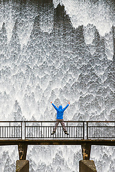 © Licensed to London News Pictures. 17/02/2020. Shap UK. Water cascades down the dam wall of Wet Sleddale reservoir near Shap in Cumbria this morning after days of heavy rain from Storm Dennis. Photo credit: Andrew McCaren/LNP