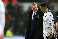 Roy Hodgson, the manager of Crystal Palace chats to Martin Olsson of Swansea city after the game. Premier league match, Swansea city v Crystal Palace at the Liberty Stadium in Swansea, South Wales on Saturday 23rd December 2017.<br /> pic by  Andrew Orchard, Andrew Orchard sports photography.