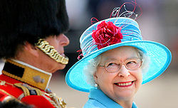 Britain's Queen Elizabeth II smiles with the Duke of Edinburgh on Horse Guards Parade during the annual Trooping the Colour parade.