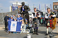 Scottish bagpipe players play next to the Dixie Dean statue ahead of the game. Barclays Premier League match, Everton v Liverpool at Goodison Park in Liverpool on Sunday 4th October 2015.<br /> pic by Chris Stading, Andrew Orchard sports photography.