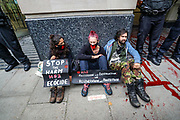 Members of Extinction Rebellion activists group appear to be glued outside Department for Transport, Great Minster House in Horseferry Road in central London on Friday, Sept 4, 2020. There are other Extinction Rebellion protests ongoing in London. Police closed Horseferry Road both ways and is working to open it. Environmental nonviolent activists group Extinction Rebellion enters its 4th day of continuous ten days protests to disrupt political institutions throughout peaceful actions swarming central London into a standoff, demanding that central government obeys and delivers Climate Emergency bill. (VXP Photo/ Vudi Xhymshiti)