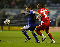 Photo: Steve Bond/Richard Lane Photography. Leicester City v Leyton Orient. Coca Cola League One. 10/01/2009. Paul Dickov (L) under pressure from Tamika Mkandawire (R)