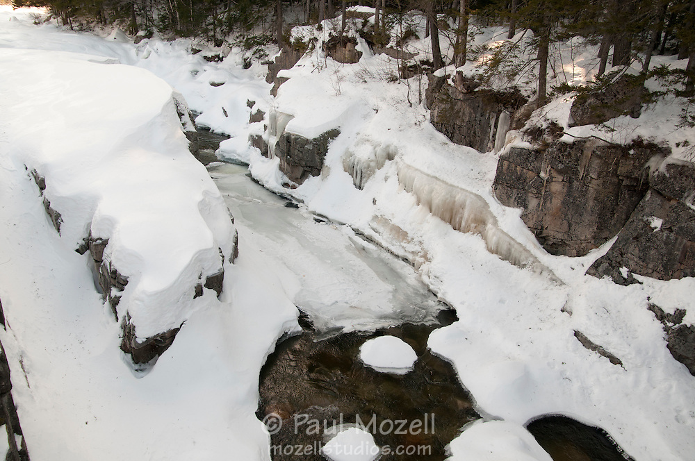 Ice and snow blanket the Swift River in the White Mountain National Forest