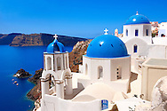 Oia, ( Ia )  Santorini - Blue domed Byzantine Orthodax churches, - Greek Cyclades islands - Photos, pictures and images .<br /> <br /> If you prefer to buy from our ALAMY PHOTO LIBRARY  Collection visit : https://www.alamy.com/portfolio/paul-williams-funkystock/santorini-greece.html<br /> <br /> Visit our PHOTO COLLECTIONS OF GREECE for more photos to download or buy as wall art prints https://funkystock.photoshelter.com/gallery-collection/Pictures-Images-of-Greece-Photos-of-Greek-Historic-Landmark-Sites/C0000w6e8OkknEb8