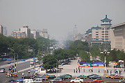 Traffic west of Tiananmen causing pollution, Beijing, China. Beijing used to be a city of cycles, but now it is a city of cars and personal car use. The resulting pollution from so many vehicles is a hugh problem for air quality in the city.