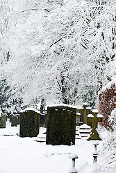 Monday January 21 Saint Marys Church Yard,  Winter Weather reaches Ecclesfield in Sheffield South Yorkshire with the promise of more to follow .21 January 2013.Image © Paul David Drabble