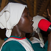 Gambela church choir, Dadaab. These refugees from Ethiopia are now part of the Christian minority among Dadaab's largely Muslim population. North Eastern Province, Kenya.