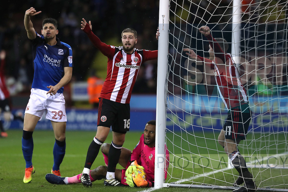 Kieron Freeman and Matt Done of Sheffield United celebrate after Lawrence Vigouroux of Swindon Town pulls the ball from behind the line during the English Football League One match at Bramall Lane, Sheffield. Picture date: December 10th, 2016. Pic Jamie Tyerman/Sportimage