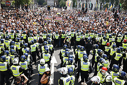 © Licensed to London News Pictures. 19/07/2021. London, UK. Police in riot gear hold back protesters trying to reach Whitehall from Parliament Square in central London on Freedom Day. All covid regulations in England are being scrapped from today even though infections and hospitalisations are on the increase. Photo credit: Peter Macdiarmid/LNP