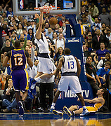 Dirk Nowitzki (41) of the Dallas Mavericks dunks the ball against the Los Angeles Lakers at the American Airlines Center in Dallas on Sunday, February 24, 2013. (Cooper Neill/The Dallas Morning News)