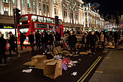 Thousands of protesters, some masked meet in Trafalgar square and march around central London marking 5th November guy fawkes night, some inceidents were reported and scuffles with the Police in Parliament square, Buckingham palace, Regent Street, Picadilly and Oxford street, London, UK.