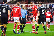 Jeremy Simpson (Referee) talks to Cauley Woodrow of Barnsley (9) and Kieffer Moore of Barnsley (19) and Paudie O'Connor of Bradford City (5) during the EFL Sky Bet League 1 match between Barnsley and Bradford City at Oakwell, Barnsley, England on 12 January 2019.