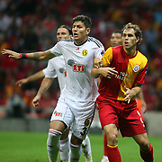 Galatasaray's Johan ELMANDER (R) and Eskisehirspor's Diego Angelo De OLIVERA (L) during their Turkish Super League soccer match Galatasaray between Eskisehirspor at the TT Arena at Seyrantepe in Istanbul Turkey on Monday, 26 September 2011. Photo by TURKPIX