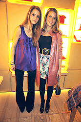 Left to right, sisters IRENE FORTE and LYDIA FORTE at a reception in aid of Children in Crisis held at the Roger Vivier store, 188 Sloane Street, London on 19th March 2009.