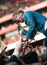 "© Licensed to London News Pictures. 01/06/2013. London, UK.   Ricky Wilson of the Kaiser Chiefs sings to and greets the audience as the band perform live at The Emirates Stadium, supporting headliner Green Day.   Kaiser Chiefs are a British indie rock band from Leeds who formed in 1996. The band consists of lead vocalist Ricky Wilson, guitarist Andrew ""Whitey"" White, bassist Simon Rix, keyboardist Nick ""Peanut"" Baines and live drummer Vijay Mistry. Photo credit : Richard Isaac/LNP"