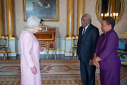 Governor-General of the Solomon Islands, Frank Kabui, accompanied by Lady Kabui, presents his credentials to Queen Elizabeth II during a private audience at Buckingham Palace, London.