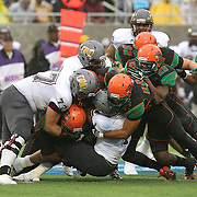 Bethune Cookman running back Anthony Jordon (1) is tackled during the Florida Classic NCAA football game between the FAMU Rattlers and the Bethune Cookman Wildcats at the Florida Citrus bowl on Saturday, November 22, 2014 in Orlando, Florida. (AP Photo/Alex Menendez)
