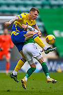 Jason Kerr (#5) of St Johnstone FC tackles Martin Boyle (#10) of Hibernian FC mduring the SPFL Premiership match between Hibernian and St Johnstone at Easter Road Stadium, Edinburgh, Scotland on 1 May 2021.