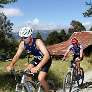Mike Shields (left) and Steve Gould in action in the bike leg of the Paradise Triathlon and Duathlon series, Paradise, Glenorchy, South Island, New Zealand. 18th February 2012. Photo Tim Clayton