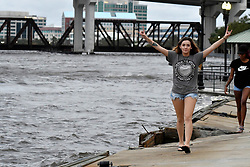 People walk around Riverwalk Brooklyn, Jacksonville after flood water resides from parts of Jacksonville, FL after Hurricane Irma took an unexpected turn and caused massive power outages and coastal flooding around the state, on September 11, 2017.