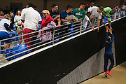 Skylar Diggens of the Dallas Wings high-fives fans as she leaves the court against the Connecticut Sun during a WNBA preseason game in Arlington, Texas on May 8, 2016.  (Cooper Neill for The New York Times)