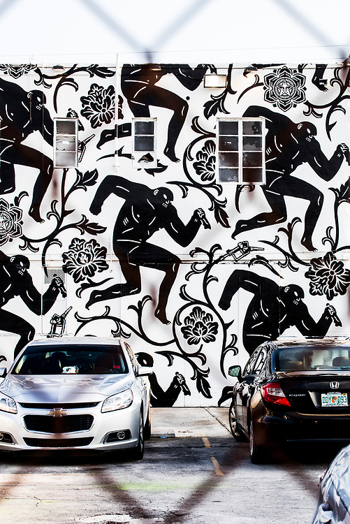 """A series of sinister men with knives in a satiric, """"Power and Glory"""" political mural by Shepard Fairey and Cleon Peterson in Miami's Wynwood district. Peterson's work often deals with themes of human brutality and violence."""