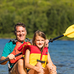 A man and his daughter on a kayak on Deboullie Pond in Aroostook County, Maine. Deboullie Public Reserve Land.