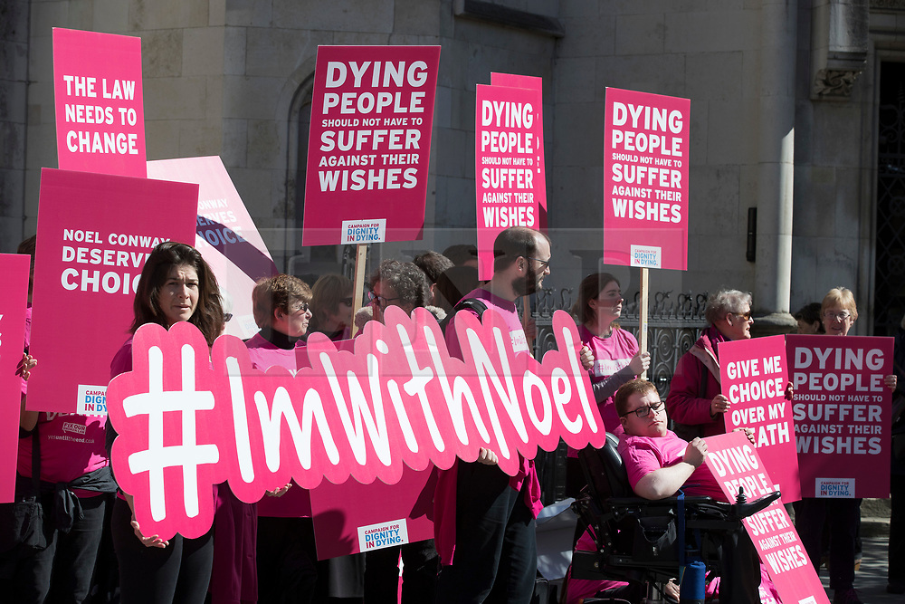 """© Licensed to London News Pictures. 01/05/2018. London, UK. Supporters of terminally ill man Noel Conway demonstrate outside The High Court as he challenges the law on assisted suicide. Mr Conway, who has motor neurone disease, is asking judges to acknowledge his """"basic right to die"""". Photo credit: Peter Macdiarmid/LNP"""