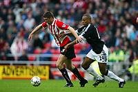 Fotball, 14.september 2002,  FA Premiership. Sunderland - Fulham 0-3. Stadium of Light. Niall Quinn, Sunderland, og Alain Goma, Fulham.