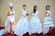WUHAN, CHINA - DECEMBER 11:   China Out - Finland Out<br /><br />toilet-paper-made wedding gowns<br /><br />Students wear toilet-paper-made wedding gowns during a Creative Wedding Dress Design Competition at Hubei University of Economics on December 11, 2013 in Wuhan, Hubei province of China.<br />©Exclusivepix