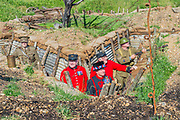 'Battlefields to Butterflies' tribute garden (created by Historic Royal Palaces gardeners) with two Chelsea Pensioners – who assisted with growing plants for the garden - and a Yeoman Warder of HM Tower of London, all of whom have served a minimum of 22 years in the armed forces -  ,Press day at The RHS Hampton Court Flower Show.
