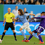 Mix Diskerud, NYCFC, is challenged by Cristian Higuita , Orlando, during the New York City FC Vs Orlando City, MSL regular season football match at Yankee Stadium, The Bronx, New York,  USA. 18th March 2016. Photo Tim Clayton