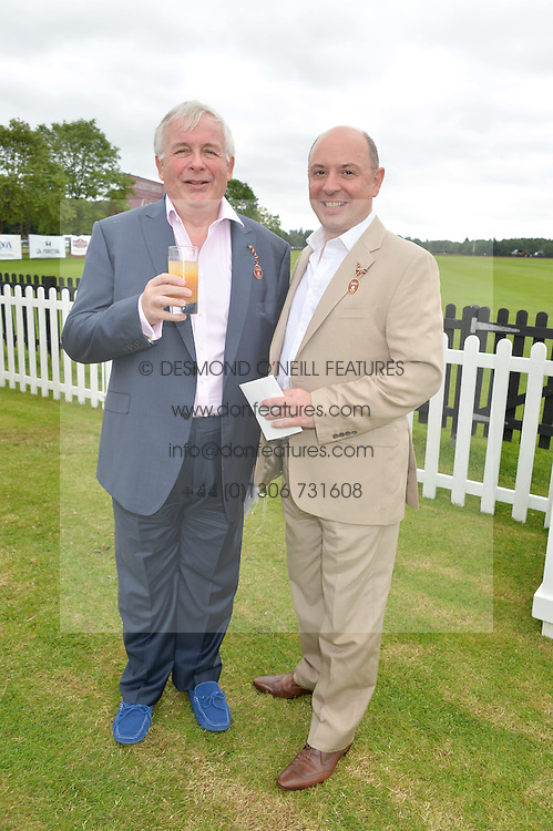 Left to right, CHRISTOPHER BIGGINS and NEIL SINCLAIR at the Cartier Queen's Cup Final polo held at Guards Polo Club, Smith's Lawn, Windsor Great Park, Egham, Surrey on 15th June 2014.