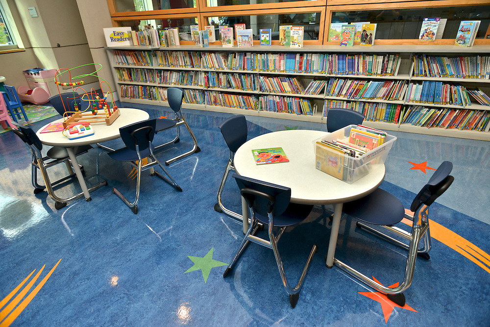 Tables with books and toys at the children's section at the Akron-Summit County Public Library.