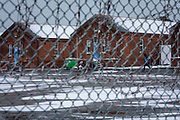 Private security guards patrol in the snow inside Napier Barracks on the 7th of February 2021, Folkestone Kent.  Men are locked up in accommodation inside Napier Barracks due to COVID-19 restrictions, Over 100 asylum seekers are being kept at Napier Barracks in unsuitable, cold accommodation, they are experiencing mental health issues as well as being vulnerable to health conditions including COVID-19. 3 people living inside the barracks have attempted suicide in 2021 already. (photo by Andrew Aitchison / In pictures via Getty Images)