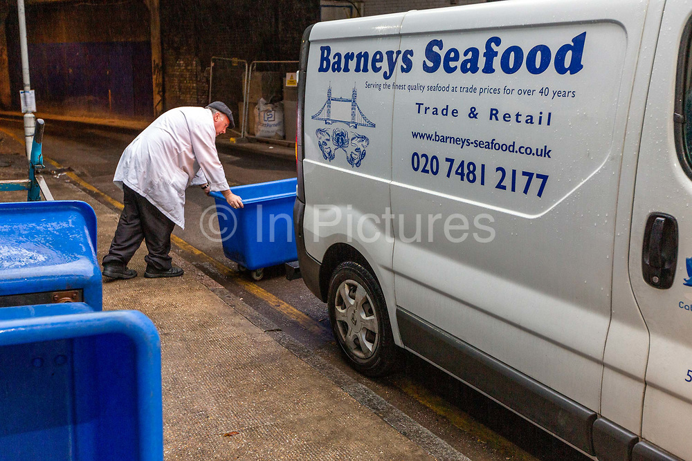 Frank Matthews loads a van with jellied eels for delivery to Pie and Mash shops on the last day at the historic Barneys Seafood in Aldgate before a move to Billingsgate Market. The famous wholesale jellied eel and shellfish business started in 1969 supplying Pie and Mash shops and shellfish stalls in East London. Jellied eels are a traditional London dish. London, United Kingdom.