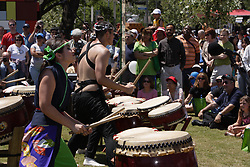Stock photo of a drum line playing native music during the grand opening festivities