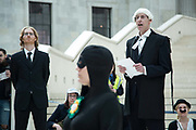 Procecutor read out the charges. BP-or-not-BP stages another of their clandestine performances at the British Museum to highlight the fact that the museum is taking money from the oil company BP. The play is about Sherlock Homes and Dr Watson who catch BP and put it on trial with procecutor and evidence of the oil spills that BP has been responsible for inthe past. Eventually BP is found guilty and ejected from the museum.