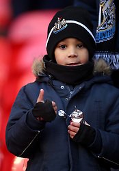 A young Newcastle United fan during the Premier League match at Wembley Stadium, London.