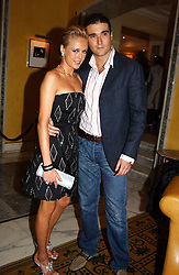 LADY ALEXANDRA SPENCER-CHURCHILL and MR DAVID PEACOCK at a party to celebrate the launch of Michelle Watches held at the Blue Bar, The Berkeley Hotel, London on 7th October 2004.<br />