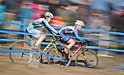 SHOT 1/12/14 2:46:48 PM - Women's Elite racers fly by the crowd at the 2014 USA Cycling Cyclo-Cross National Championships at Valmont Bike Park in Boulder, Co.  (Photo by Marc Piscotty / © 2014)