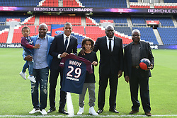 PSG's new player Kylian Mbappe is unveiled alongside Paris Saint Germain president Nasser Al-Khelaifi during a press conference at the Parc des Princes, following his transfer from Monaco FC to Paris Saint Germain, France, on September 6, 2017. The 18-year-old Mbappé, who was born in Paris, will initially make the move to PSG from French champions Monaco on a one-year loan before signing a permanent deal. Photo by Laurent Zabulon/ABACAPRESS.COM
