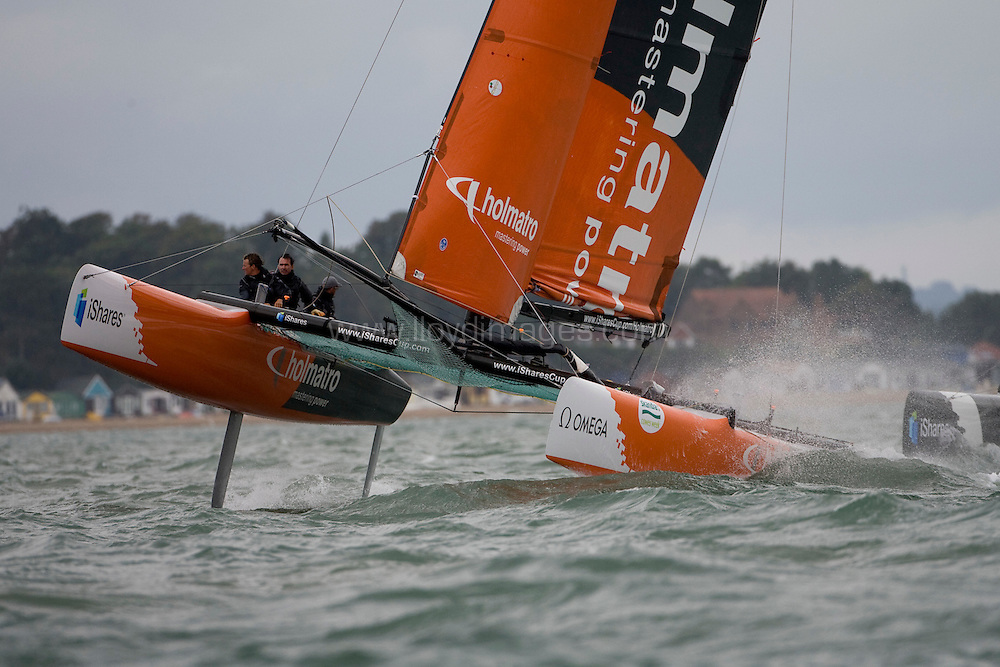 """Day three of Skandia Cowes Week 2008 (Sunday) ..iShares Cup Extreme 40 racing...""""Team Holmatro"""" speeding along on one hull expertly skippered by Andreas Hagara...Please credit all pictures """"Lloyd Images"""""""