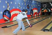 Teen plays ten pin bowling