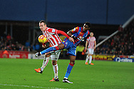 Glenn Whelan of Stoke city is challenged by Wilfried Zaha of Crystal Palace (r). Barclays Premier league match, Stoke city v Crystal Palace at the Britannia Stadium in Stoke on Trent, Staffs on Saturday 19th December 2015.<br /> pic by Andrew Orchard, Andrew Orchard sports photography.