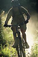 A mountain biker rides dusty singletrack trail in Jackson Hole, Wyoming.