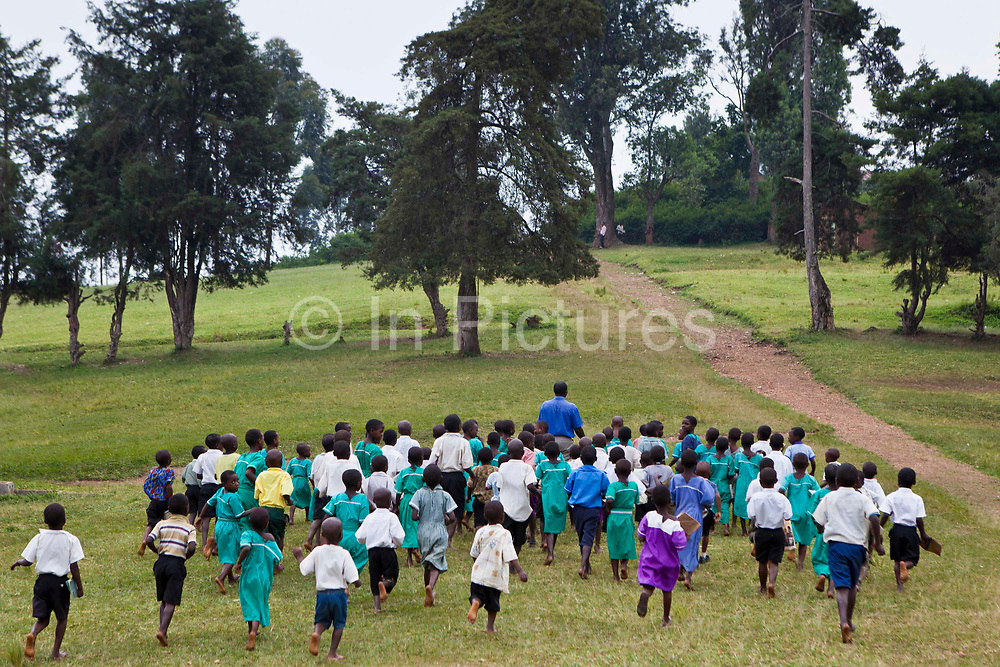 At Nyamiyaga primary school the head teachers leads the children to a health outreach program run by Bwindi Community Hospital.  As part of the outreach programme they cover 32 primary schools and 5 secondary schools in the region as well as many communities. The main Bwindi Community Hospital is in Buhoma village on the edge of the Bwindi Impenetrable Forest in Western Uganda. It serves around 60,000 people from the surrounding area.