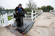 Lock operator on the Sharpness Canal at Frampton on Severn in Gloucestershire, United Kingdom. The Gloucester and Sharpness Canal is a canal in the west of England, between Gloucester and Sharpness; for much of its length it runs close to the tidal River Severn, but cuts off a significant loop in the river, at a once-dangerous bend near Arlingham. It was once the broadest and deepest canal in the world.