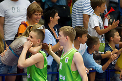 Klemen Prepelic of Slovenia with his girlfriend and Miha Lapornik of Slovenia  celebrate after winning the basketball match between National teams of Latvia and Slovenia in Qualifying Round of U20 Men European Championship Slovenia 2012, on July 16, 2012 in Domzale, Slovenia. Slovenia defeated Latvia 69-62. (Photo by Vid Ponikvar / Sportida.com)
